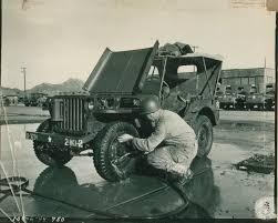 army jeep ww2 us serviceman washing jeep at camp san luis obispo california on