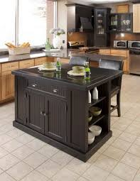 small black island with storage wooden cabinets large glass window