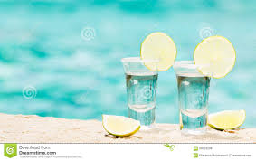 tequila shots with lime on blue background stock photo image