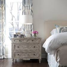 cream and gray bedroom with cream distressed french nightstands