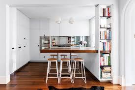 kitchen white cabinets black handles mirror splashback