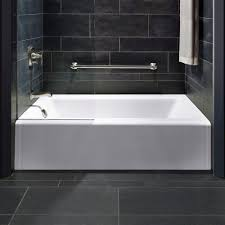ceramic flooring tile with white abthtub and kohler stainless