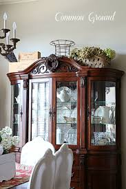 how to arrange a corner china cabinet common ground ideas on styling a cabinet or cupboard top