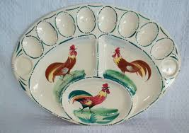vintage deviled egg platter vintage deviled egg tray is oval with three roosters rooster
