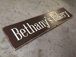 custom message sign in black with painted letters in a rustic wood