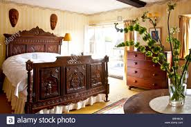 bedroom with old style wooden furniture hotel room interior stock