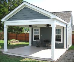 garage with porch outbuilding with covered porch outside