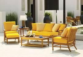 impressive decoration plant beside yellow outdoor patio furniture