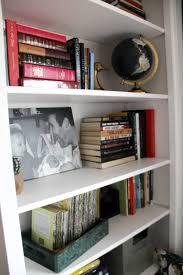 reading nook with built in bookshelves bright green door