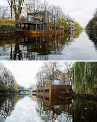 Friday Floatwing by 11 Awesome Examples Of Modern House Boats Contemporist