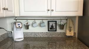 declutter kitchen countertop with a curtain rod hometalk