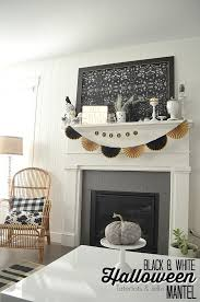 decorating in white black and white neutral halloween mantel decorating ideas