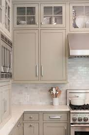 beige painted kitchen cabinets love the small marble backsplash subway tile in brick pattern
