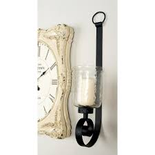 31 in wrought iron candle sconce with glass hurricane holder