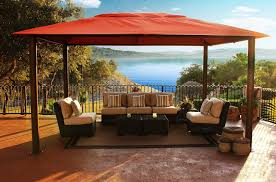 red wooden patio canopy in large balcony with black metal fence