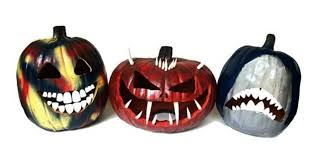 these creepy pumpkin teeth are the best halloween decor you can