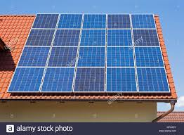 solar panels on roof solar panels on the red house roof solar energy background stock