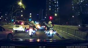 beating the red light in front of 2 traffic police driver beats red light makes left
