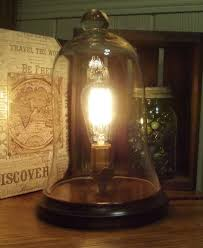 glass bell jar lamp with vintage edison style light bulb cabin