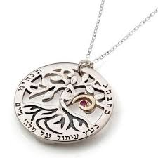 silver and gold circle of tree necklace with ruby
