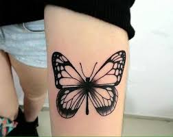 watercolor butterfly on left forearm