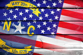 North Carolina Flag Usa And North Carolina State Flag On Wood Background Stock Photo