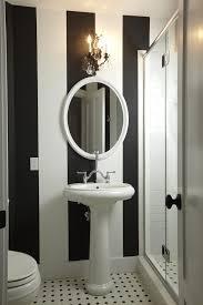 Black Oval Bathroom Mirror Black White Stripe Walls Bathroom Traditional With Vertical