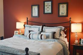orange accents wall painted of modern bedroom design idea feat