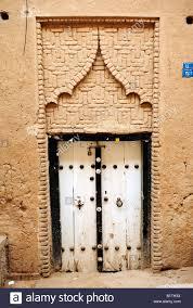 iran yazd door showing two different types of door knockers one