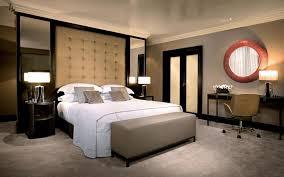 cherry wood frame of circle mirror cream cushion and headboard in