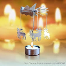 rotating spinning tea light carousel candle holder new
