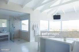 Modern White Bathroom - modern bathroom with ocean view stock photo getty images