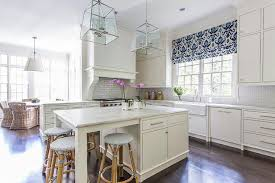 what is a shade of white for kitchen cabinets white kitchen with blue ikat shade transitional