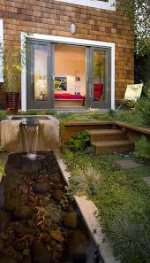 backyard fish pond patio contemporary with walkway solid color