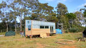 tiny homes on wheels the cedar siding for our tiny house on wheels is going up