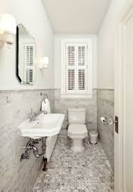 bathroom narrow bathroom with gray stone wainscoting also wall