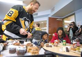 pensgiving day players serve thanksgiving meals at rainbow