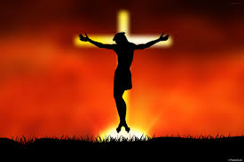 jesus christ hanged on glowing cross in the sky stock photo by