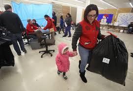 catholic charities gift coordinator brings to the