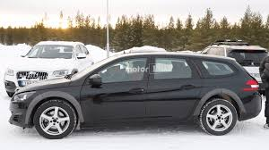 peugeot 508 2018 2018 peugeot 508 spied hiding underneath 308 wagon mule