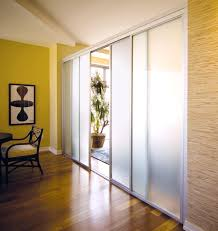 Bookcase With Sliding Glass Doors by Using Curtains As Room Dividers White And Brown Sliding Doors