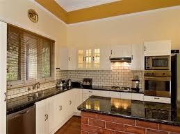 brick backsplash in kitchen black and blue kitchen cabinets blue