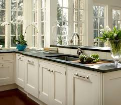 granite countertops for ivory cabinets 28 best black granite countertops images on pinterest aqua kitchen