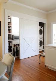 Sliding Barn Doors A Practical Solution For Large Or by 25 Ideas To Hide A Laundry Room Sliding Barn Doors Laundry