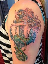 cool watercolor mermaid on right thigh by sophiaviolette