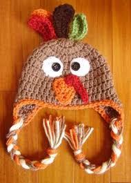 a knit hat that looks like a roasted turkey turkey hat knit