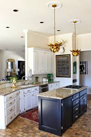 White Kitchen Black Island Kitchen Makeover White Cabinets Black Island Brass