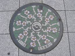 hunting manhole covers woven words cover in osaka dotonbori idolza