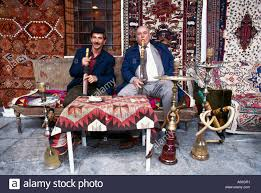 two men smoking hookah on sofa istanbul turkey stock photo