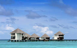 Maldives Cottages On Water by Holiday In The Maldives In Cottages On The Water Stock Photo